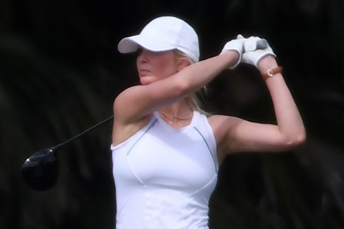 Ivanka Trump exhibits off her golf swing in all-white outfit – however narrowly misses out on a spherical with dad