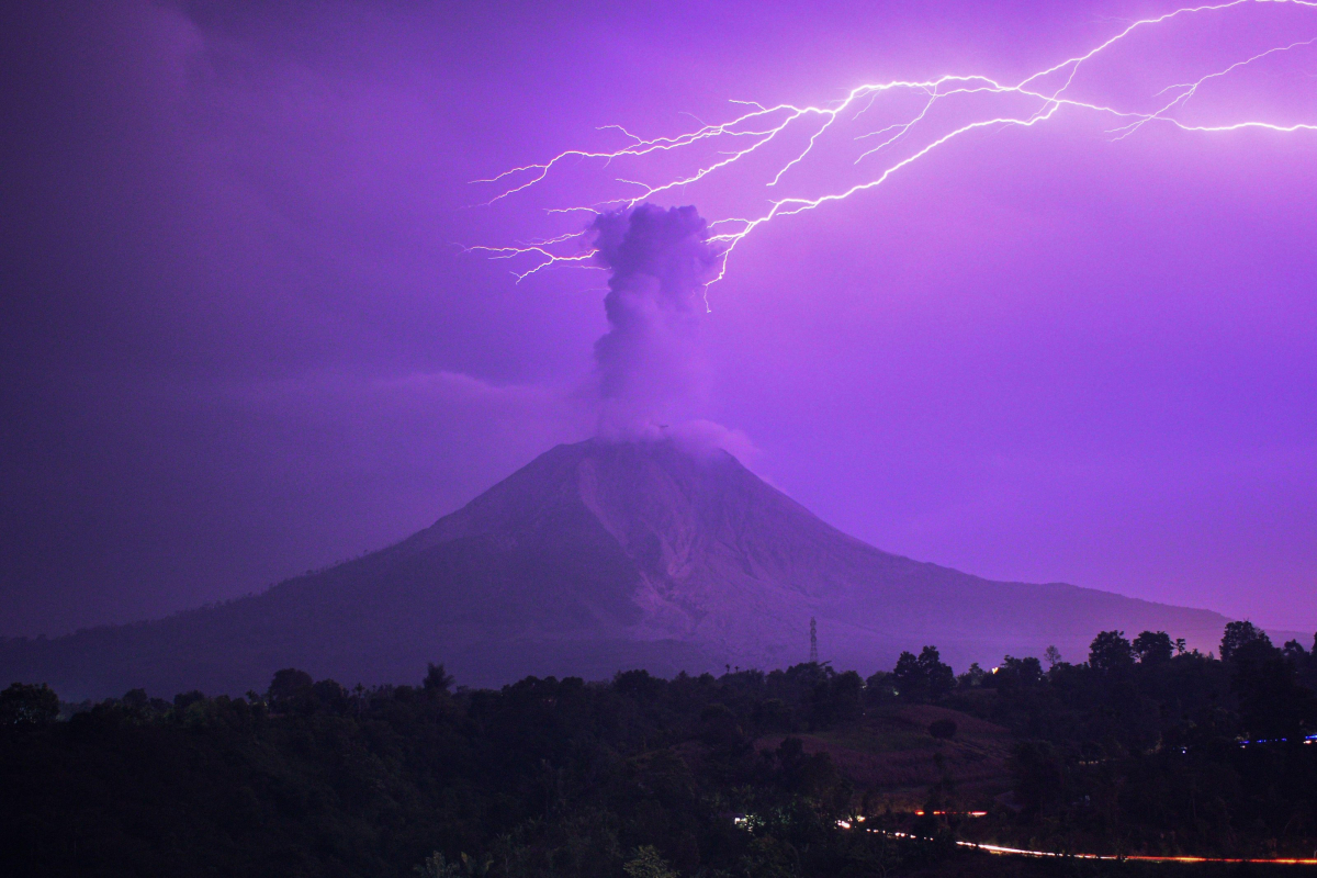 Lightning strikes erupting Mount Sinabung volcano because it spews ash cloud 16,000ft into the sky