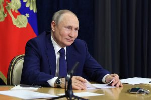 Putin to sign 'extremist' bill banning critics from running in looming election as he fears being 'toppled like Gaddafi'