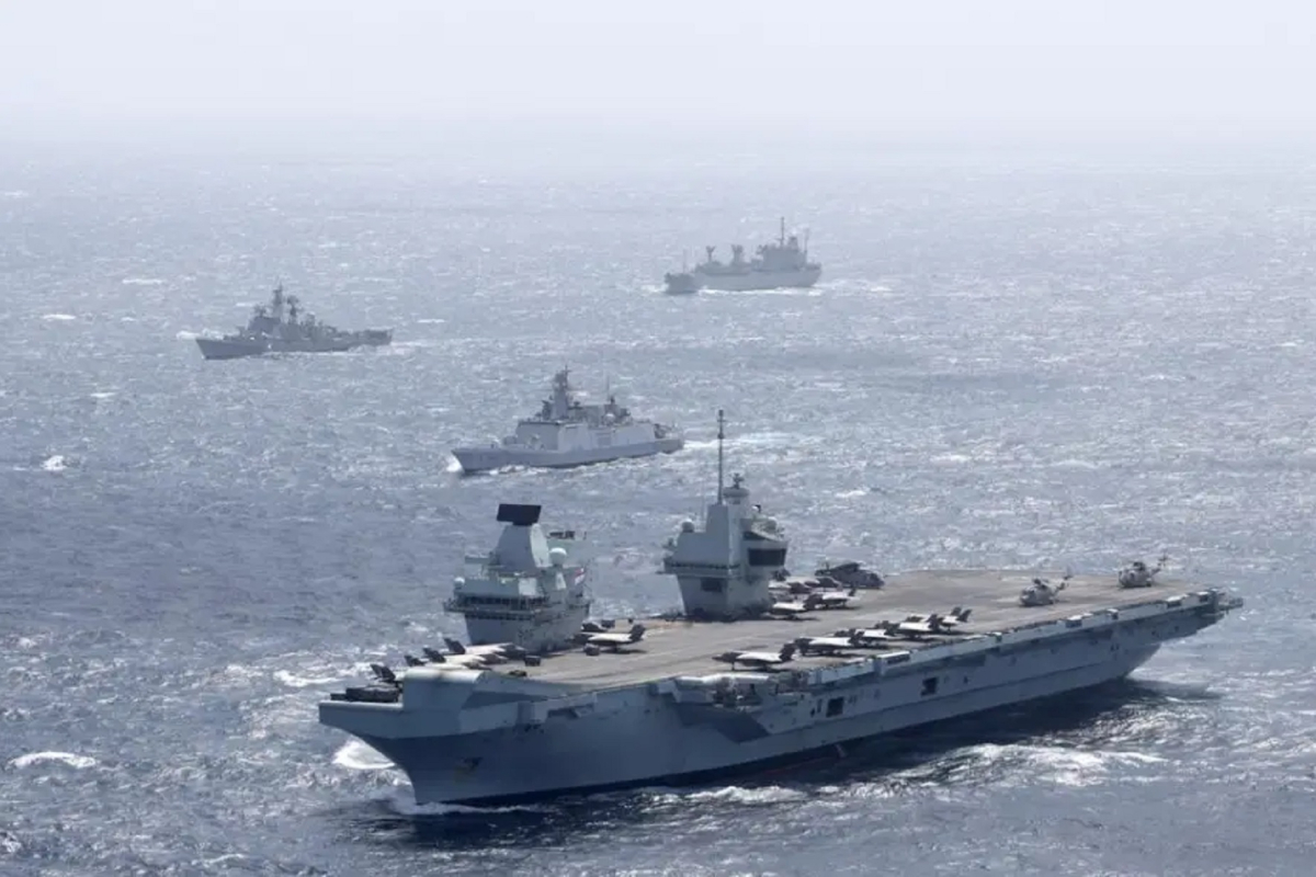 Britain dangers China's wrath by crusing largest warship into South China Sea regardless of Beijing warning of 'punishment'