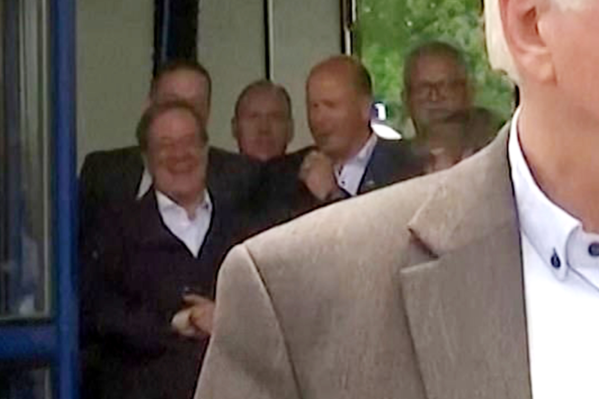 Outrage as German minister is caught LAUGHING when go to city devastated by floods as loss of life toll rises to 143