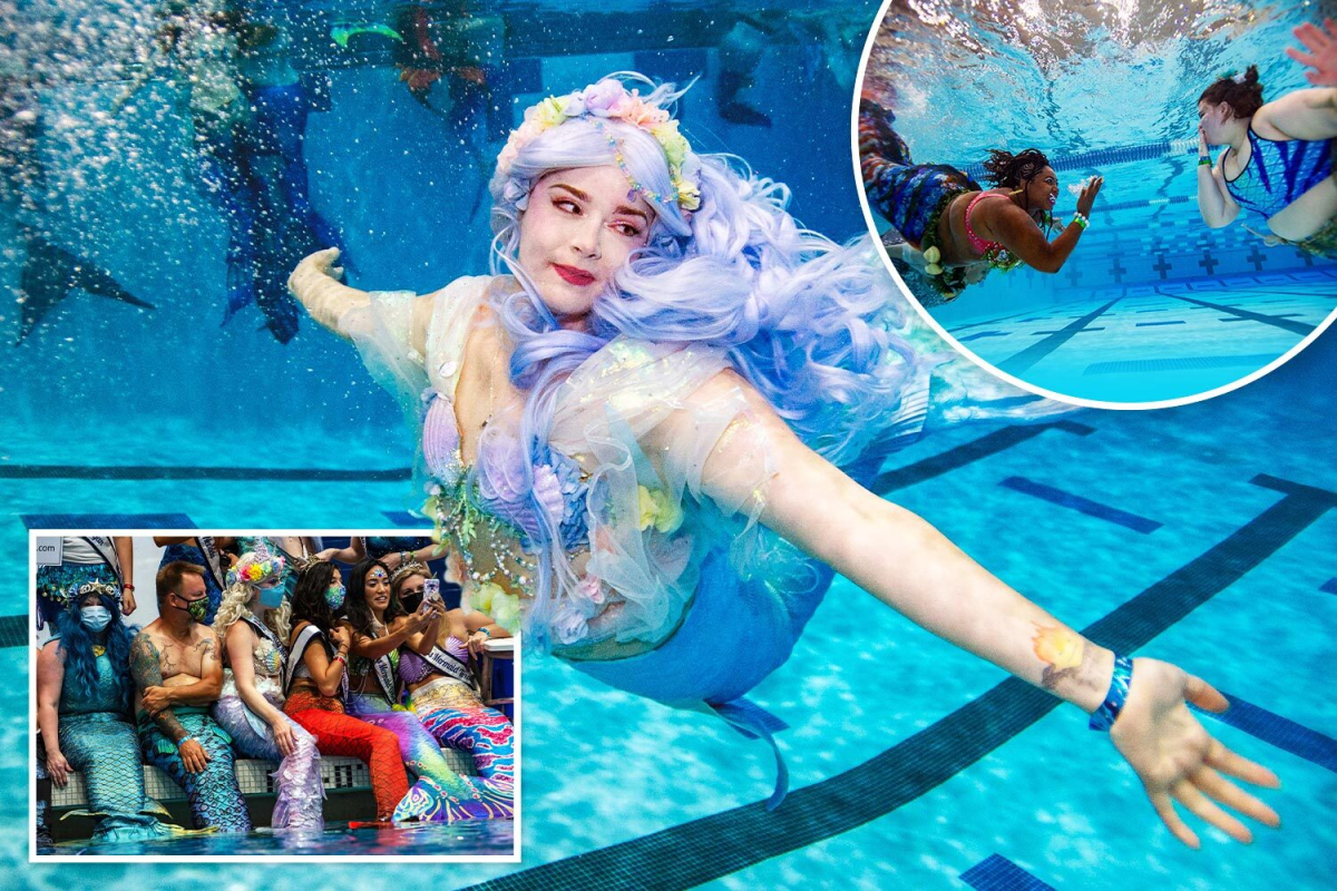 Ladies in costumes glide by the water at world's largest mermaid conference