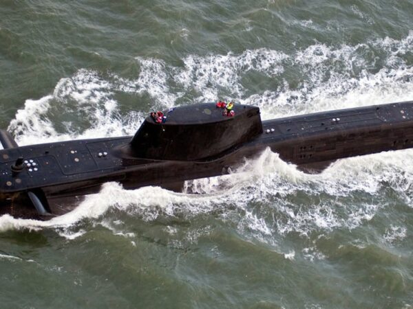 France warn efforts to cease migrants crossing Channel might be scuppered after Britain's submarine cope with Australia